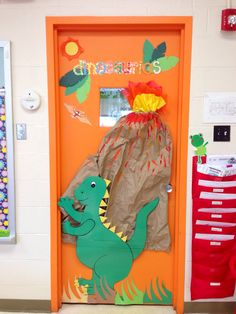 Look at the brown paper bag they used as a volcano for the dinosaur classroom theme!