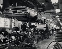 Working on the assembly line in the Chrysler Corporation plant in Detroit, Michigan, 1964.