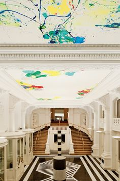 Théâtre Royal de la Monnaie, Brussels, entrance hall decorated by Sam Francis (the colorful ceiling) and Sol LeWitt (the black-and-white marble tiling). From The Most Beautiful Opera Houses in the World © @ABRAMS  2013. Photo: © Guillaume de Laubier #opera #architecture