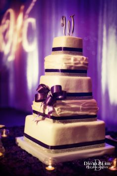 The Ribbon Around Cake And Up Lighting Along Walls Intentionally Go Together