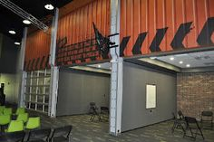 Worlds of Wow - cool glass garage doors act as large entries into small group rooms in this themed youth environment at FBC Colleyville, TX.