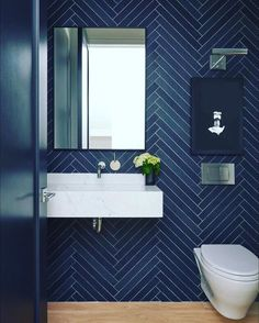 Navy feels a little retro, but the herringbone tile layout brings it back to modern Bad Inspiration, Bathroom Inspiration, Modern Bathroom Design, Bathroom Interior, Bathroom Designs, Dark Blue Bathrooms, Modern Powder Rooms, Tile Layout, Herringbone Tile