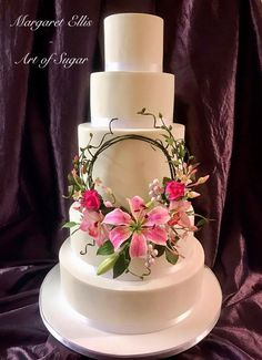 Stargazer lily, buds and foliage, Cymbidium Orchids and buds, Rose buds, Chinese Jasmine and foliage. Set on a freehand Covered wire Hoop. Created for a new class 😊🌸🌹💕 Unique Cakes, Creative Cakes, Beautiful Cakes, Amazing Cakes, Stargazer Lily Wedding, Lily Cake, Heart Shaped Cakes, Fashion Cakes, Sugar Craft