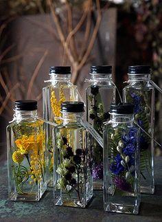 昨日、JAZZRIZE STORE さんへ納品して来ました。お届けしたアイテムの紹介です。2、3個並べて飾るといい感じのハーバリウム。発色のきれいな植物... Dried Flower Arrangements, Dried Flowers, Jar Crafts, Diy And Crafts, Apothecary Decor, Perfume, Potion Bottle, How To Preserve Flowers, Mason Jar Wine Glass