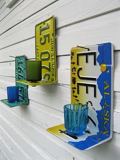 license plate project | Old license plates, fashioned into wall sconces. Oh, and the glass ...