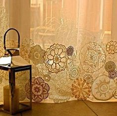 Vintage lace doilies attached to the bottoms of sheer curtains. Don't the different shapes and shades make this look awesome. If yours don't HAVE this variation, you can dye some of  them with tea, coffee, or other 'staining' agents.And vary the TIMES they are left in the solution for.