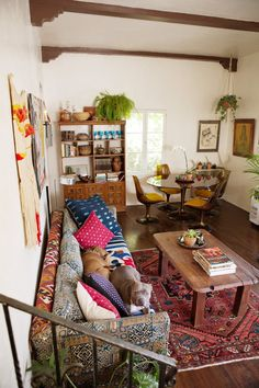 Are you a big fan of spaces that are bursting with design, accessories, colors and patterns? But are you a little worried about how to make it work in the real world (and specifically, your home)? We've got real-life living rooms that are bursting with style but that work — and we're breaking down the lessons to take with you into your own space!