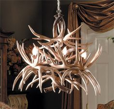 The Cascade Faux Deer Antler Chandelier has 19 realistic whitetail deer shed antler replicas. They are meticulously intertwined to hold 6 lights - perfect for entry ways or dining rooms. Deer Antler Chandelier, Antler Lights, Branch Chandelier, Antler Art, Rustic Chandelier, Chandeliers, Lodge Style Decorating, Lodge Decor, Decorating Ideas