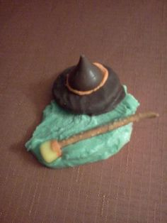 Wicked Witch of the West Meltdowns!    For hat I used Oreo fudge covered cookie, orange frosting and a Hershey's kiss. The broom is a pretzel stick with the bottom of a candy corn.  I use Wilton meltable candy disks for the melted body.  Use a teaspoonful of melted candy and spread out, place hat and broom on and let harden.