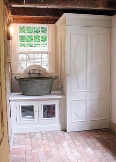 I'd really like for the small sink in the mudroom to be bedside the washer and dryer but be vintage like this one.