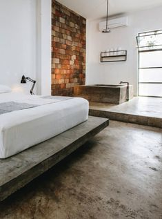 concrete floors, bath and platform bed at drift san jose. Boho Bedroom Decor, Home Bedroom, 1920s Bedroom, Earthy Bedroom, Quirky Bedroom, Queen Bedroom, Minimalist House Design, Minimalist Room, Brown Furniture