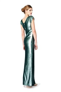 This PLAKINGER Debut Collection glamorous full-length evening gown features elongating silhouette and shiny turquoise sequined fabric. byplakinger.com