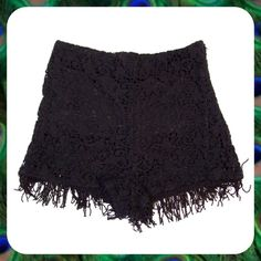 """Black Crochet Lace Fringe Booty Shorts Size M Super cute crochet lace shorts in black. High waisted short shorts with dainty fringe trim. 100% Cotton with soft, stretchy lining. Hidden side zip closure. Size M or 6/8 for ladies with a 29"""" waist. Length: 12"""".       Bundle 2 or More Items and Save 15% Off Automatically!  Honey Punch Shorts"""
