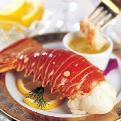 """Lobster... the Rolls Royce of the food world. Nothing says """"class"""" like a well-prepared lobster dish.    Make yours a night to remember. Serve succulent... Lobster Dishes, Lobster Recipes, Seafood Recipes, Seafood Dishes, Shrimp And Lobster, Lobster Tails, Fish And Seafood, Steam Recipes, Wine Recipes"""