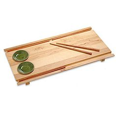 @Overstock.com - Enjoy your meal with this large sushi board from J.K. Adams. This stylish board is made from maple wood and offers an elegant way to present food. Two ceramic dipping bowls and four chopsticks are included, making this set practical and enticing.http://www.overstock.com/Home-Garden/J.K.-Adams-Tabeyo-Large-Wood-Sushi-Board/4721906/product.html?CID=214117 $55.99