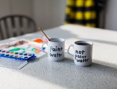 Paint Water / Not Paint Water Mugs by Hallie Bateman – The Colossal Shop For anyone who's ever dunked their brush in the tea!