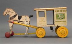 """RICH TOYS BORDEN''S HORSE-DRAWN DAIRY WAGON Morrison, Illinois, Early 20th Century <br /> Metal and wood. Height 9"""". Length 19.5""""."""