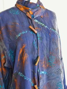Diane Ericson Design - I layered 2 collars together on this blue stenciled shirt. After brush painting with copper...I stenciled with the Deco Bird Stencil in the turquoise to create the surface design.  I also folded the original collar and used it as a cuff instead!!!