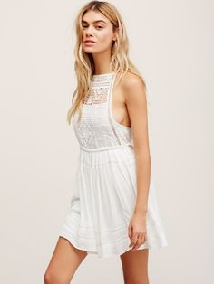 Emily Dress   Featuring a crochet bodice this super femme mini dress has pleat detailing on the skirt and adjustable ties at the waistband. Skirt and front part of the bust are lined.