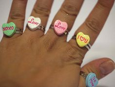 """Super Cute Valentine Heart Candy Ring in 7 Different Designs  It measures approx. 0.50 inch wide and is on a silver plated adjustable bang that will fit most ring sizes.  Please put the design that you would like in the """"Message to Seller"""" section upon check out. 6 DESIGNS: XOXO, Kiss Me, Cal..."""