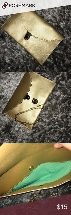 Large gold clutch NEW Never used. Clutch with chain strap. Bags Clutches & Wristlets