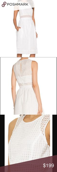 """Elizabeth and James Heidi Dress (002) Jacquard-woven gridwork conceals and reveals in turn, presenting a vintage-inspired frock with an of-the-moment modern twist. * 41.5"""" long * Back keyhole with rouleau-button closure. * Hidden back-zip closure. * Lined. * 100% polyester * 16.5"""" across bust, 14"""" across waist, 22"""" across waist. Elizabeth and James Dresses"""