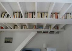 Bookshelves and staircase combined. Apartment Therapy house tours are usually good for tips for compact living combining function and style. Also from Apartment Therapy, another cool idea - the ceiling bookshelf. Book Storage, Hidden Storage, Diy Storage, Storage Spaces, Book Shelves, Storage Ideas, Storage Solutions, Extra Storage, Creative Storage