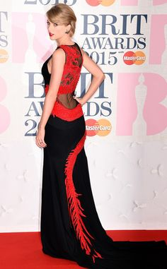 Look back at it! TSwift's feisty Roberto Cavalli Atelier gown is the perfect blend of edge and sophistication.