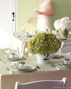 Enamel pails overflowing with fresh green and white hydrangeas are charming for an informal reception table.