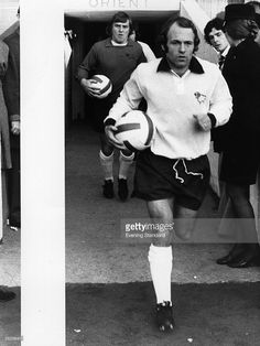Scottish international footballer Archie Gemmill runs out on to the pitch before a match for Derby...