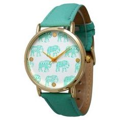 """The perfect accent for work apparel and casual weekend ensembles, this charming watch features a leather band and a tribal elephant-print face.   Product: WatchConstruction Material: Alloy, stainless steel, leather and glassColor: MintFeatures:  Adjustable buckleGlass has a protective mineral coatingAccommodates: Battery - includedDimensions: 9"""" W x 0.75"""" D (flat)"""