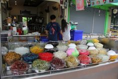 Nam kaeng sai (shaved ice dessert with all sorts of toppings such as coconut milk, syrups, water chestnuts, candied taro and other fruits, etc) - by Migration Mark, via Flickr