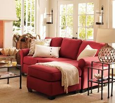 Love this couch! Perfect spot to relax with a book in front of the fireplace.