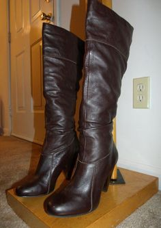 Ooh Merci!  Dark chocolate thrifted boots by Jessica Simpson!