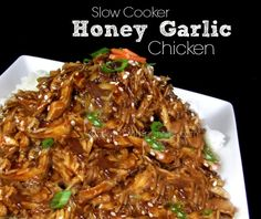 Slow Cooker Honey Garlic Chicken!  Delicious piled up on a bed of rice!