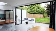 Bi Folding Sliding Patio Doors Aluminium up to wide 4 Panel The Doors, Windows And Doors, House Extension Design, House Design, Extension Ideas, Rear Extension, Bifold Doors Onto Patio, Kitchen Bifold Doors, White Bifold Doors
