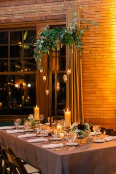 Wow, where do we even begin with this Chicago wedding? Held in the Prairie-style venue at Cafe Brauer in Lincoln Park, florist Phil Cooper of Kehoe Designs created an amazing candlelit floral and garland chuppah that is just jaw-dropping. Suspended from the ceiling, the lush garland extended all the way down to the floor for the ceremony, creating an incredibly intimate […]