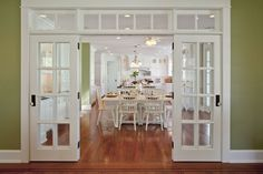 French doors separating kitchen from living area