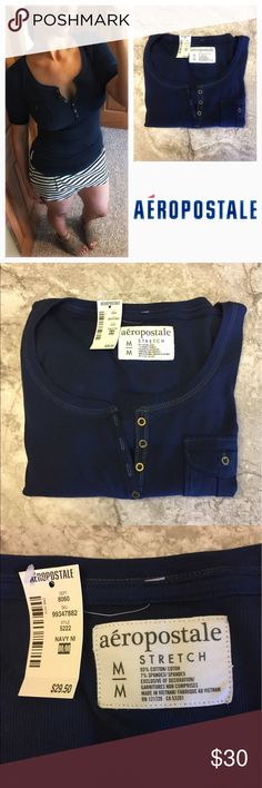 """Aéropostale stretch blue Henley shirt NEW Medium Aéropostale stretch blue Henley shirt with pocket  Brand new with tags. Deep blue in color with 7 brassy buttons down the front plus a small chest button pocket. Soft stretchy fabric: 93% cotton, 7% spandex. Rounded hemline, Aéropostale logo tag in front on bottom. Flat measurements: 14.5"""" across chest, 25.25"""" long. Smoke/pet free home.  Aero Stretch Henley Blue Top Pocket Medium Sexy Casual Aeropostale Tops Tees - Short Sleeve"""