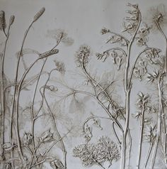 Dried wild flowers, glue and white Spray paint. Rub Dark umber acrylic to accentuate.