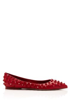 Signature red hue and edgy studs elevate everyday ballet flats