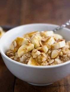 A simple recipe for steel cut oats made easily in a rice cooker and topped with banana, honey, and almonds. Perfect breakfast! |#breakfast #recipe #breakfastrecipe #yummy #healthy  pinchofyum.com