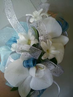 Wrist corsage Prom. With orchids and hyacinth pips. Accented with Fitz bling.