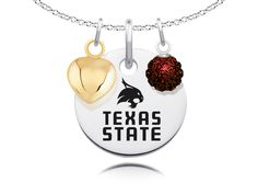 Texas State Bobcats Necklace with Charm Accents. This Collegiate Necklace has it all! Our round collegiate pendant is accented with a sterling silver gold plated puffed heart charm and a sparkly crystal ball representing the school colors.