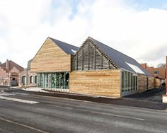 bplusb architectures adds gable-roof to dainville library