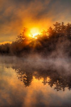 If HOPE AND DREAMS could be painted into a picture, this morning light chasing off dark would be fitting art! #DDO:) MOST POPULAR RE-PINS - http://www.pinterest.com/DianaDeeOsborne/hope-and-dreams/ - As the orange sun rises behind the hills, its reflection on the still lake waters, the foggy mist rises. Another sunrise, another Day for Hope dispelling the darkness of night. Also on my SKYLIGHTS board, full of sunrise and sunset photos. Free SONGS of hope, comfort at…