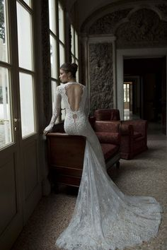 Fall in love with the deep open back design of this long-sleeved lace @BERTA gown with a flowing lace train. | See more here: Berta Bridal Couture 2014 Winter Collection | Confetti Daydreams ♥  ♥  ♥ LIKE US ON FB: www.facebook.com/confettidaydreams  ♥  ♥  ♥ #Wedding #WeddingDress #WeddingGown