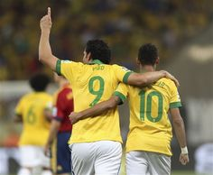 Brazil's Neymar, right, embraces Fred after he scored his side's third goal against Spain during the soccer Confederations Cup final match at the Maracana stadium in Rio de Janeiro, Brazil, Sunday, Ju