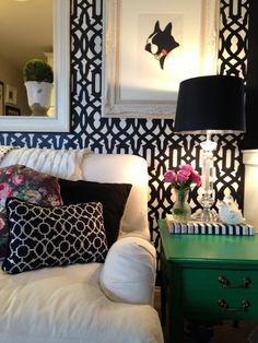 A black and white Trellis Allover stenciled accent wall in a living room.