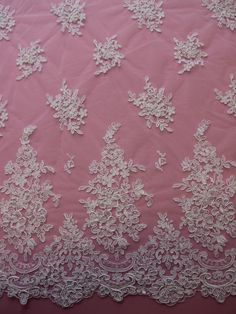 BARBIE is a relatively simple yet elegant design with a tasteful border with scalloped edges and 2 different sizes of floral motifs running into the body of the design. The floral motifs are shaded using a lustrous embroidery thread and then highlighted with a fine cording. Measures 132cms wide and has identical scalloped edges. It is available on ivory only. Wedding Dress shown in photos 1 & 3 are made with our BARBIE lace and FIESTA tulle. Please contact us if youd like a quote for your…